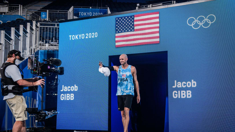 Jake Gibb enters the Olympic stadium one last time