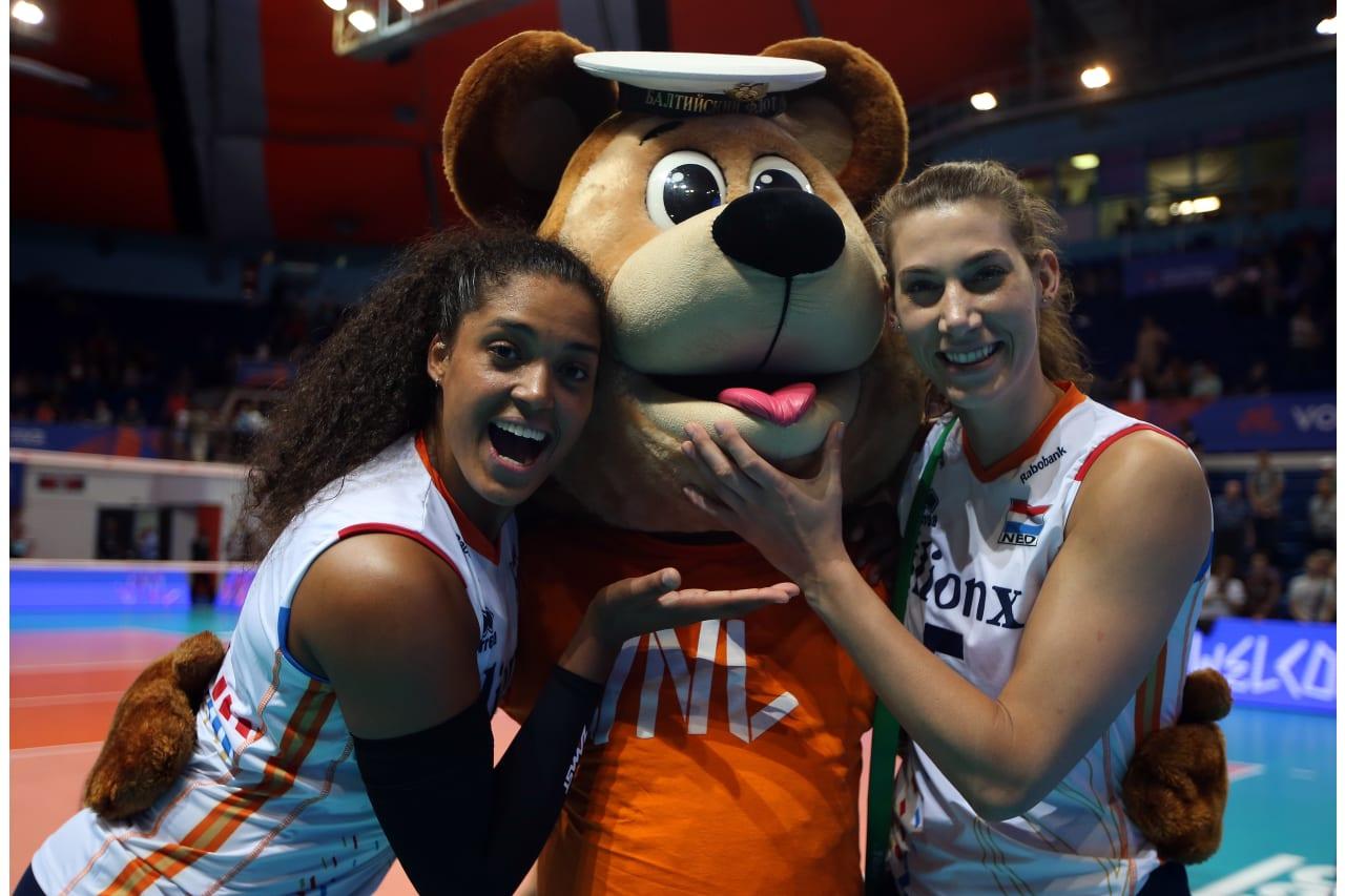 Celeste Plak and Robin De Kruijf (Netherlands) with the Russian mascot
