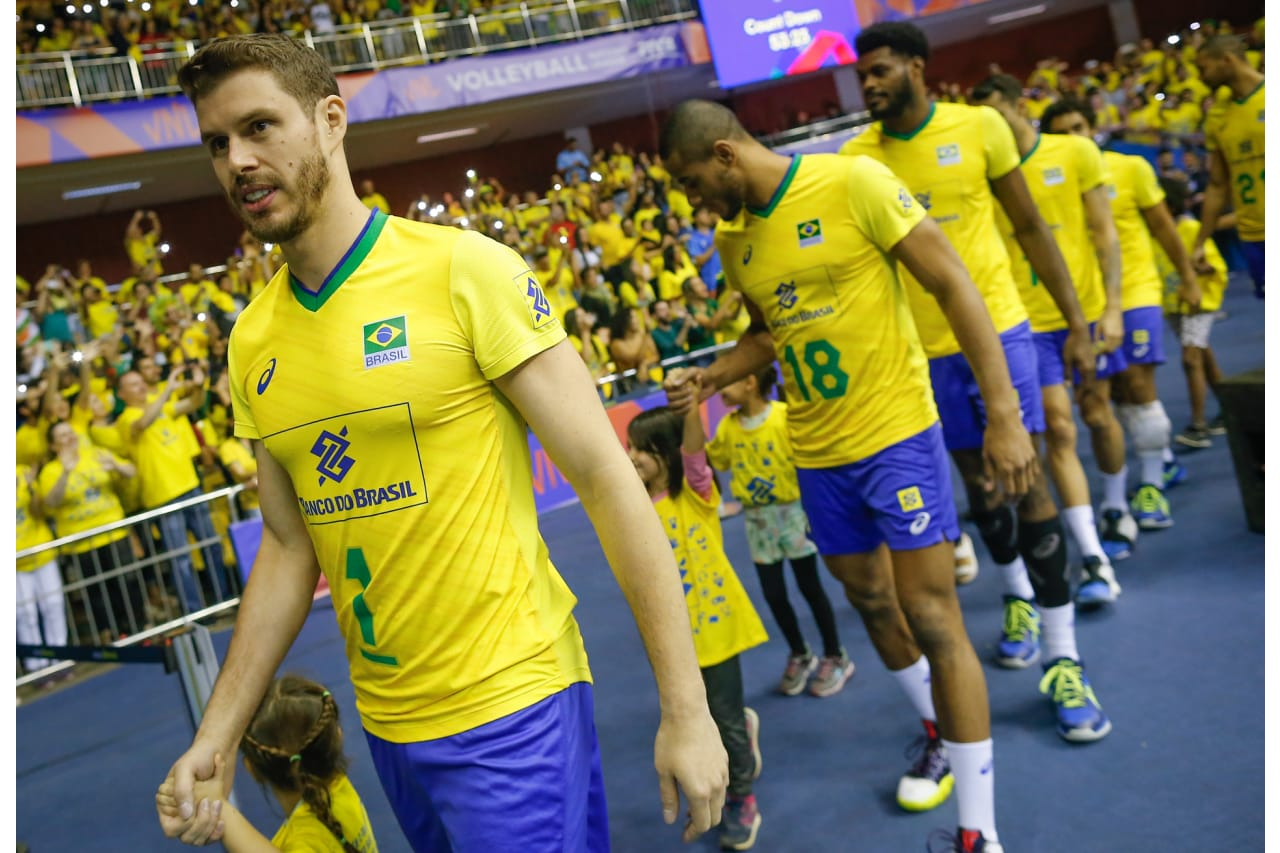 Brazilian team enter the hall for the match against Italy