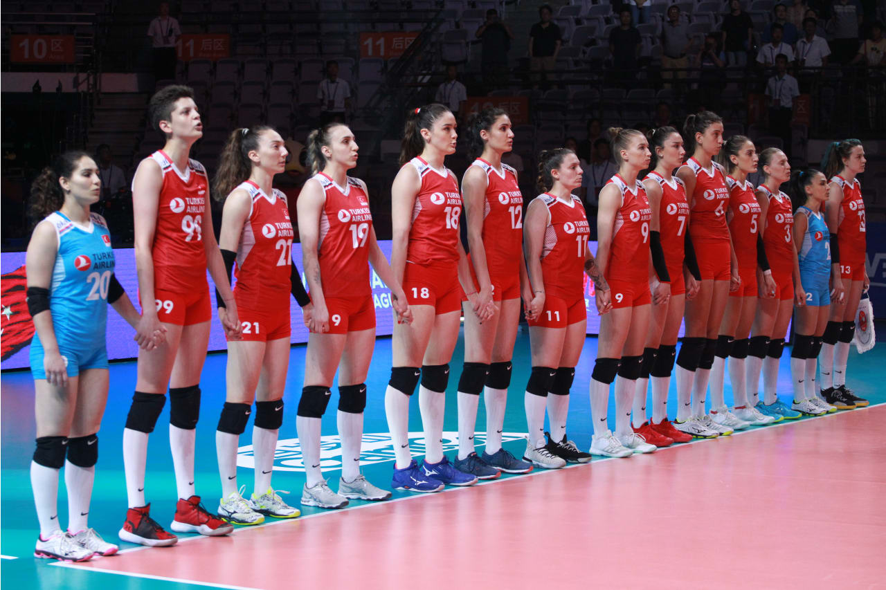 Turkish players put their hands together as their national anthem is played