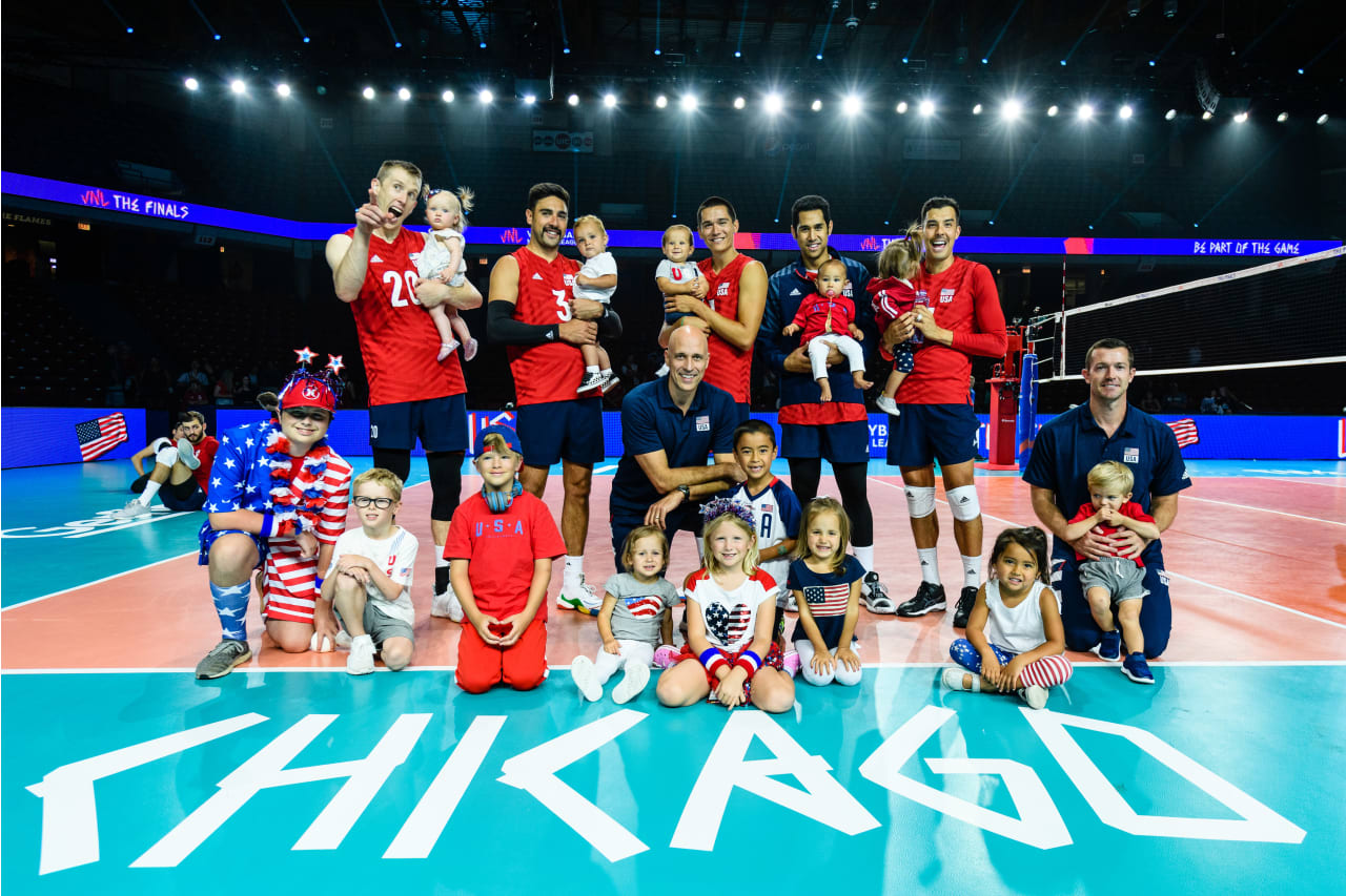 American players and staff with their kids after match against France at the Chicago Finals