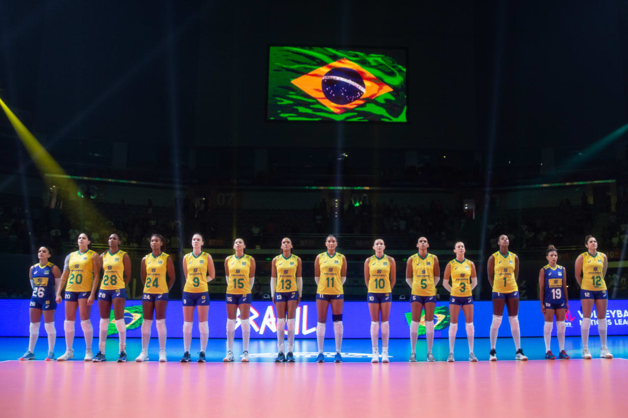 Brazil players stand above their flag as their national anthem is played