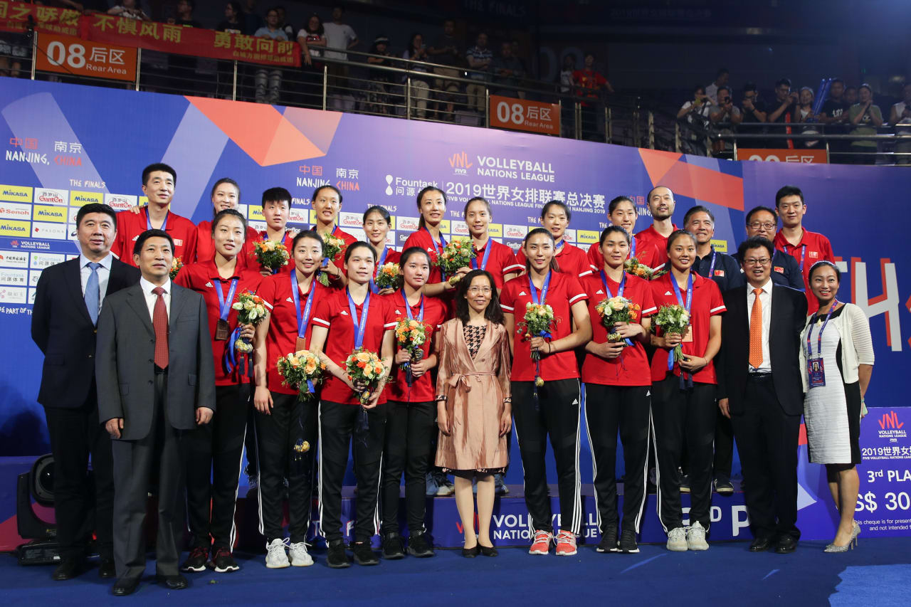 Chinese players stand on the podium as bronze medal winners