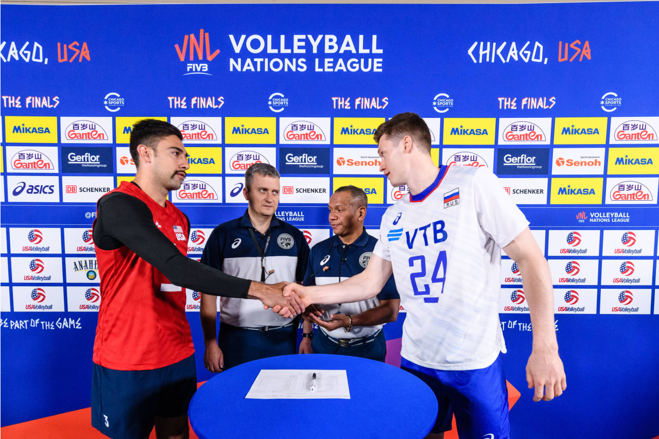 USA's Taylor Sander and Russia's Igor Kobzar shake hands before a Volleyball Nations League Finals gold medal match between USA and Russia at Credit Union 1 Arena in Chicago Illinois on July 14, 2019.