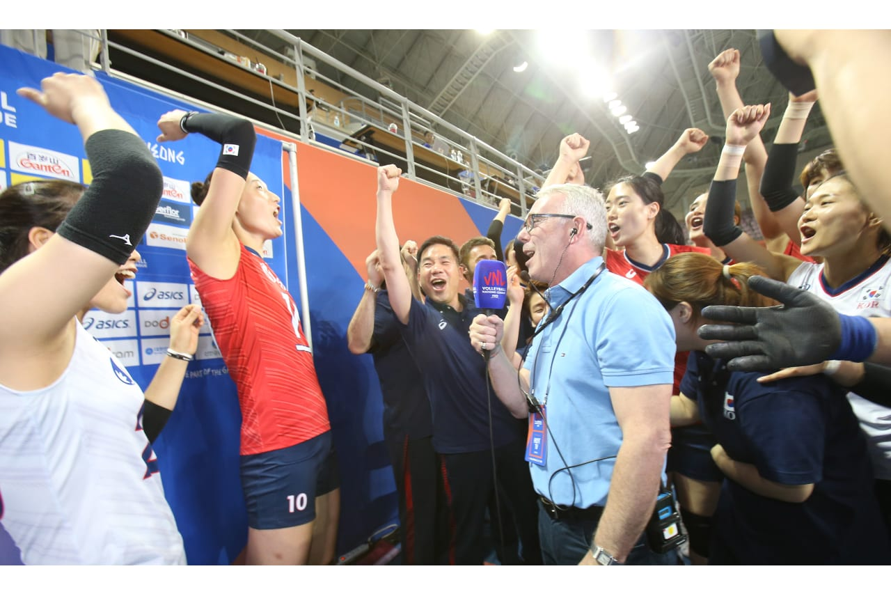 YeonKoung Kim (Korea) and her teammates celebrate their victory in the middle of a TV interview