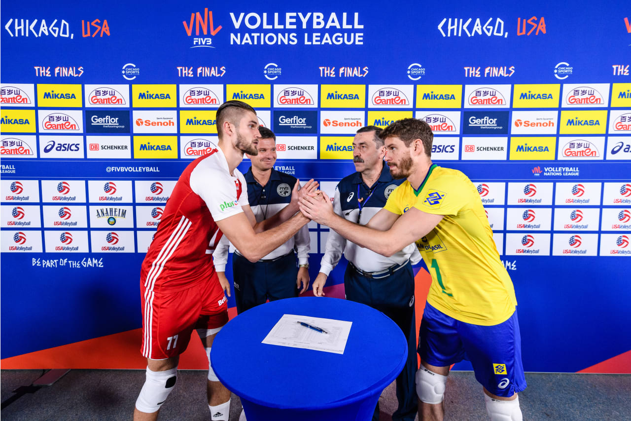 Captains of Karol Klos (Poland) and Bruno Rezende (Brazil) at the coin toss before the bronze medal match