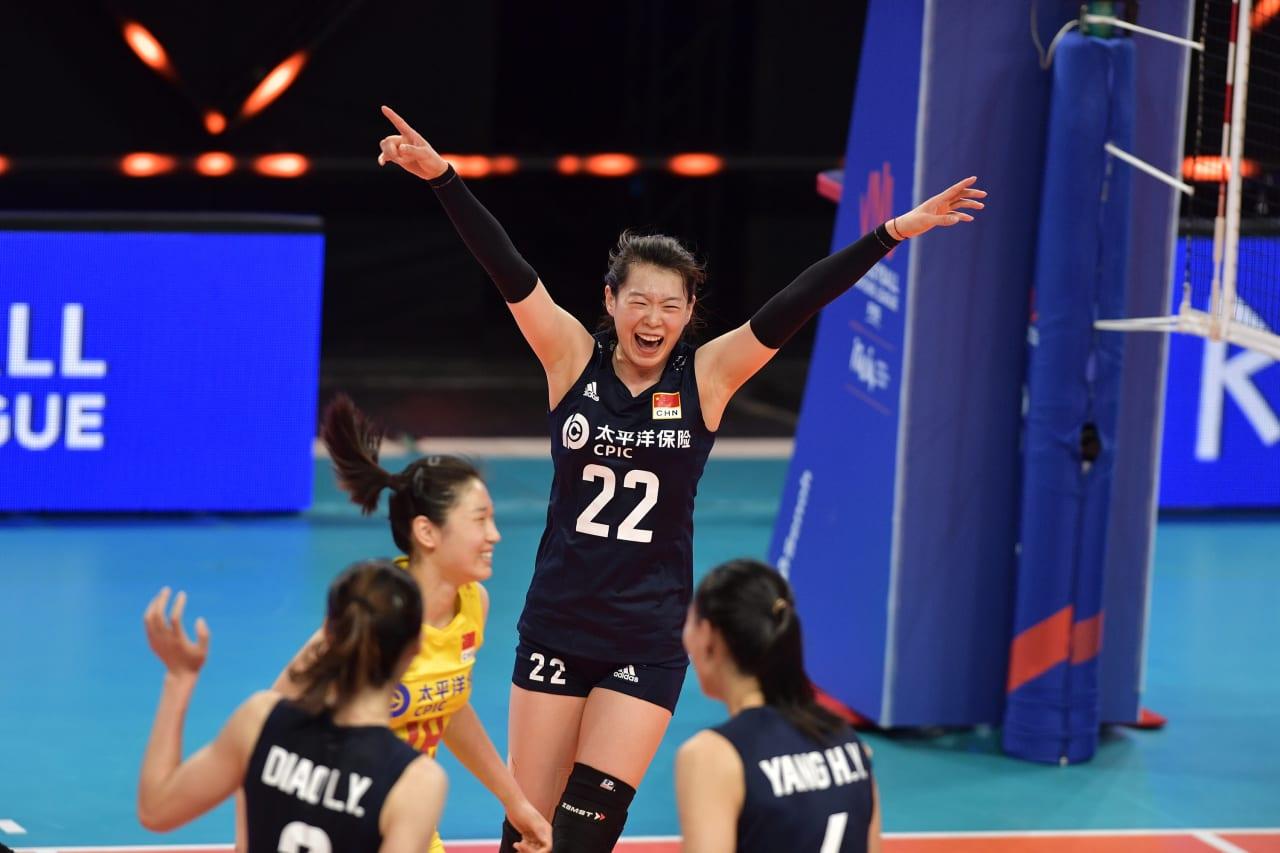 Team China celebrate a point