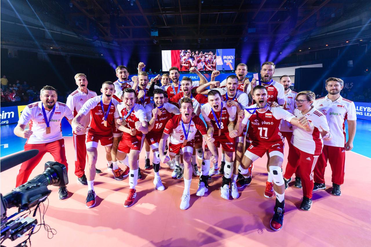 Poland players pose with their bronze medals around their necks