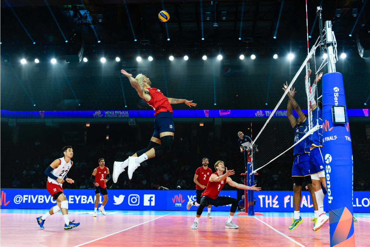 USA's Benjamin Patch jumps to spike from the backcourt