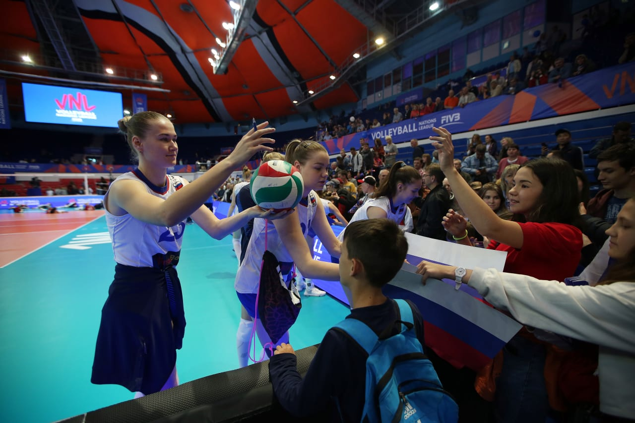 Russian players sign balls for the supporters