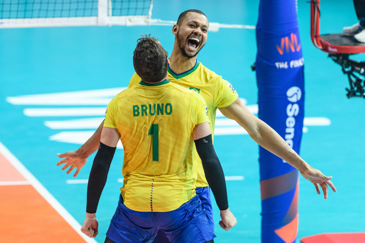 Brazil's Alan de Souza (21) and Bruno Rezende (1) chest bump in celebration