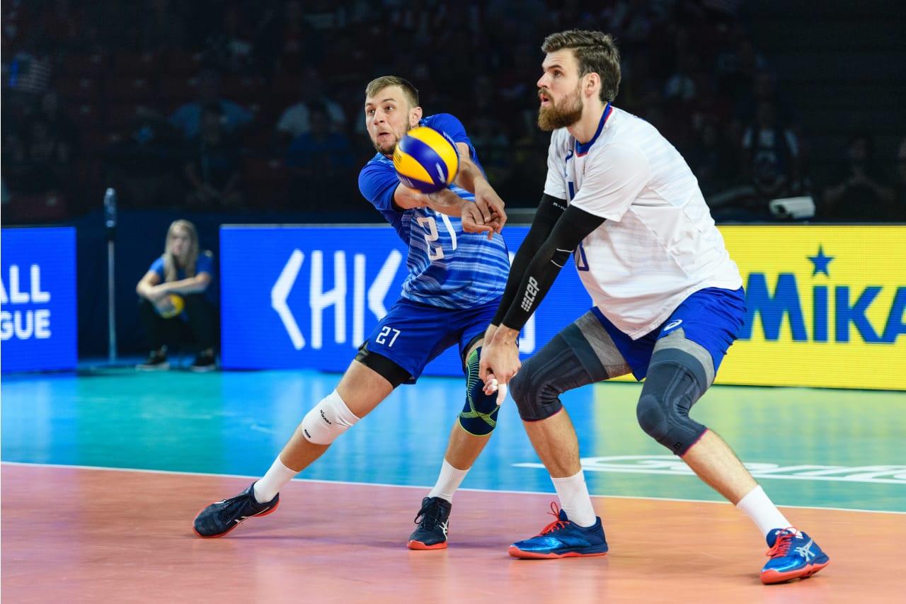 Russia's Valentin Golubev digs the ball