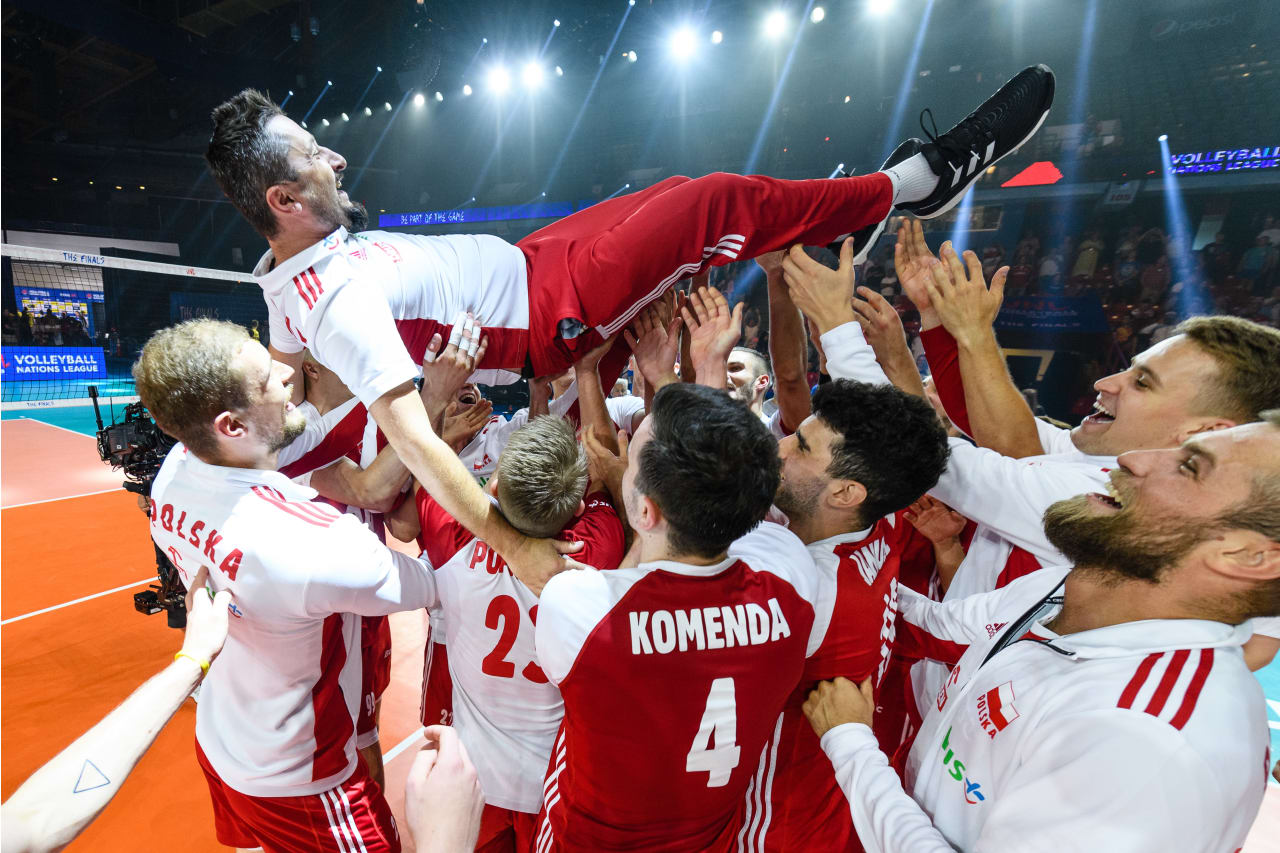 Poland players lift a coaching staff member in celebration