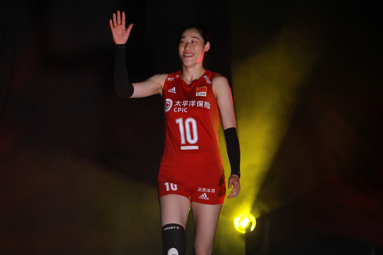China's captain Liu Xiaotong waves to the fans as she enters the court