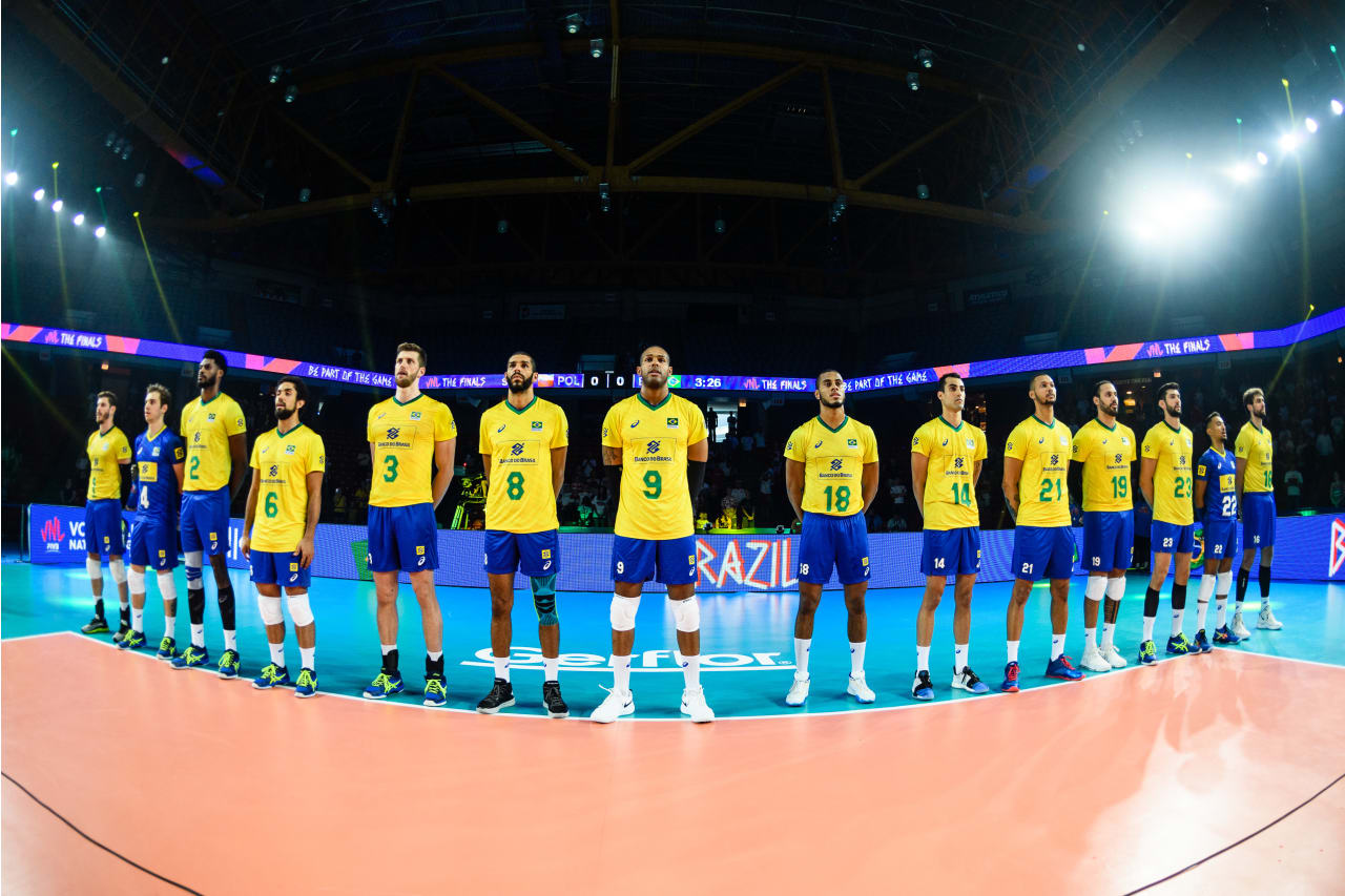 Brazil players stand in line during their national anthem