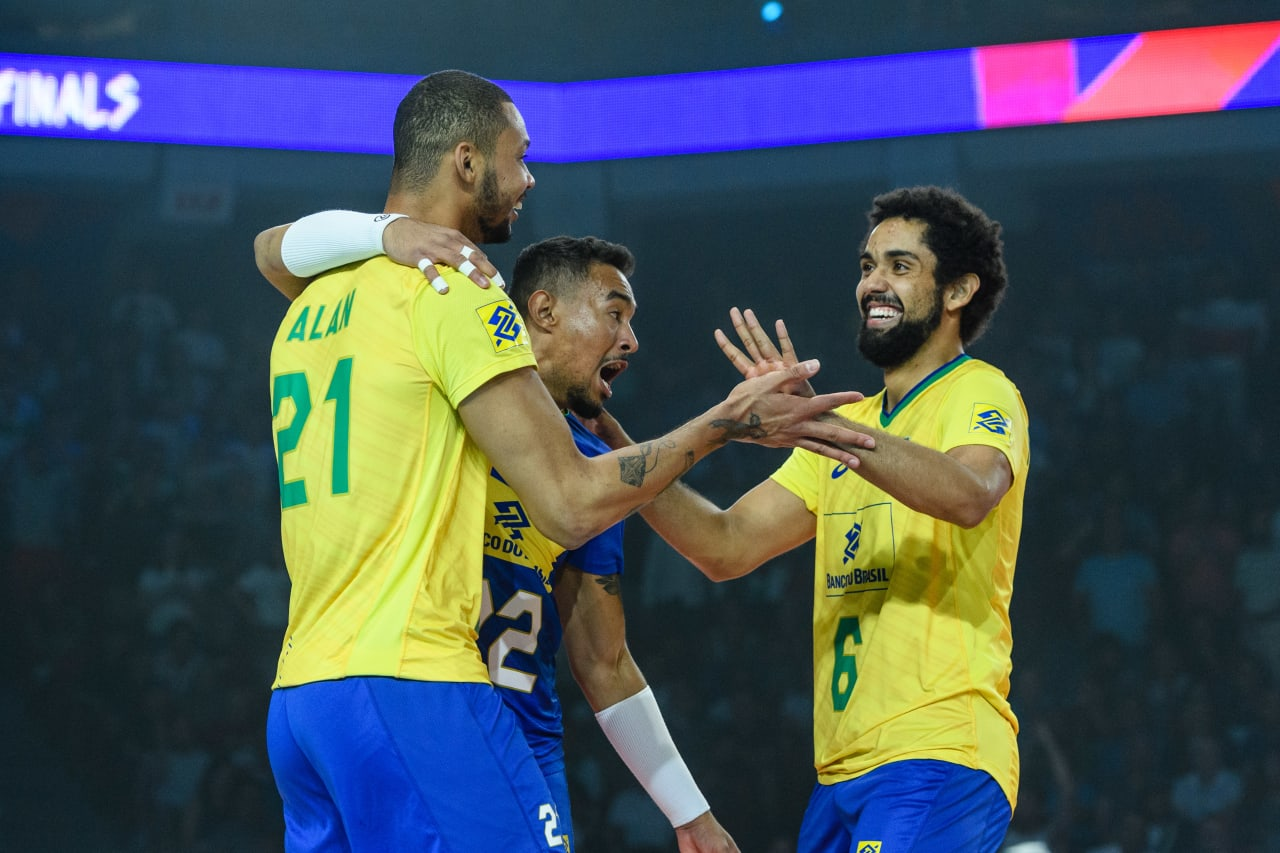 Brazils's Alan de Souza (21), Maique Nascimento (22) and Fernando Kreling (6) celebrate a point