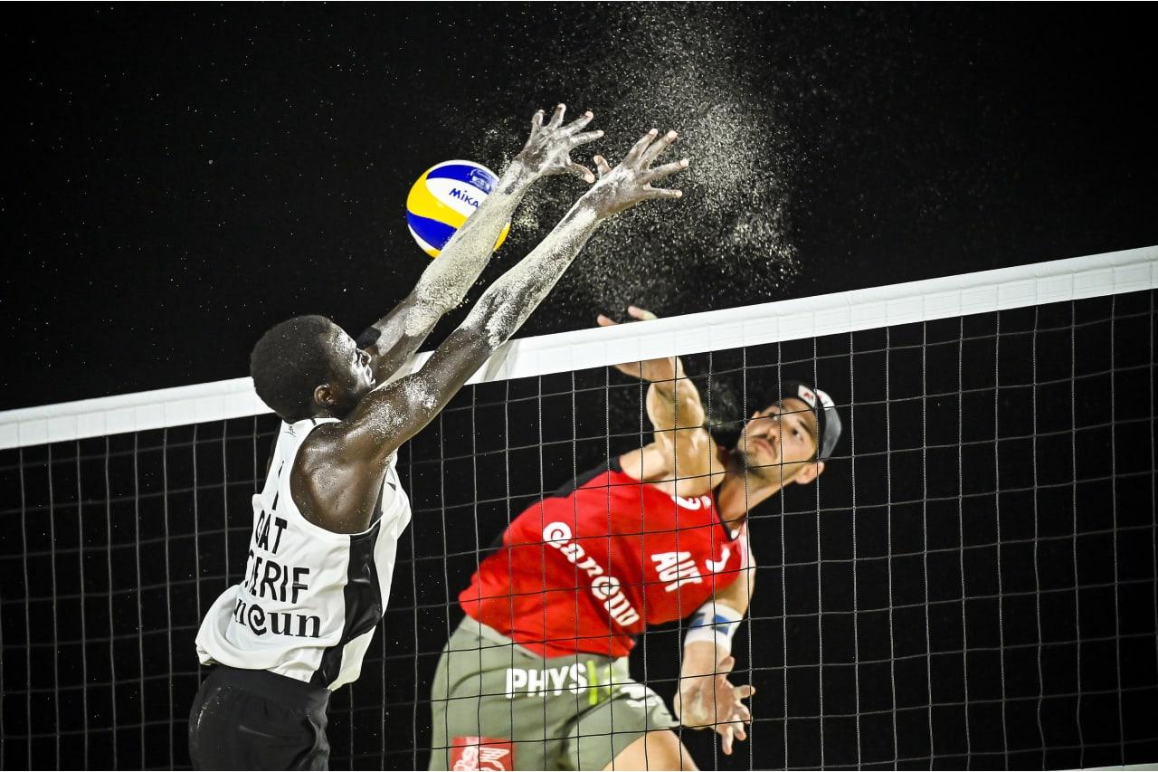 Cherif Younousse (Qatar) blocks a shot by Martin Ermacora (Austria)