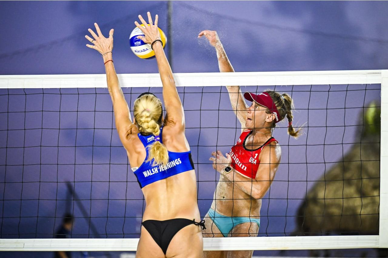Kerri Walsh Jennings (USA) blocks a shot by Aprill Ross (USA)