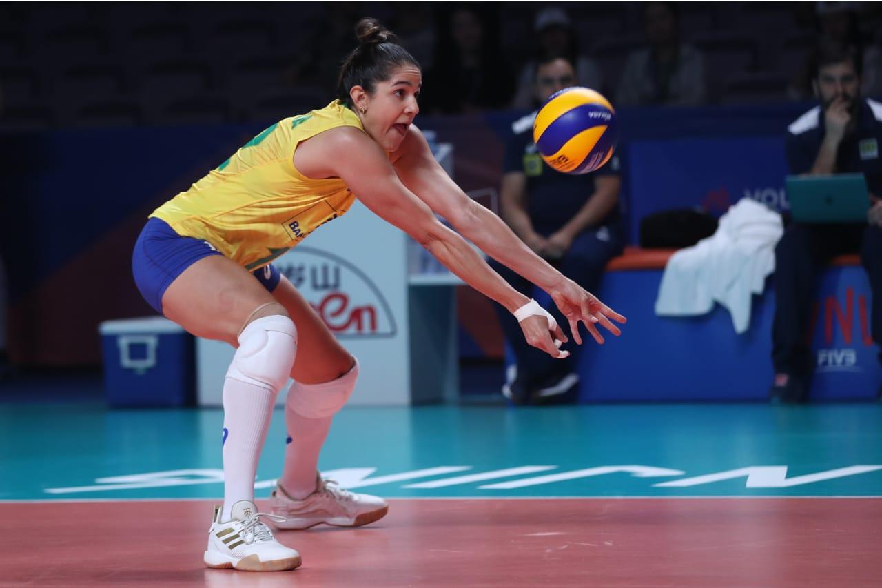 Brazil's Natalia Pereira receives