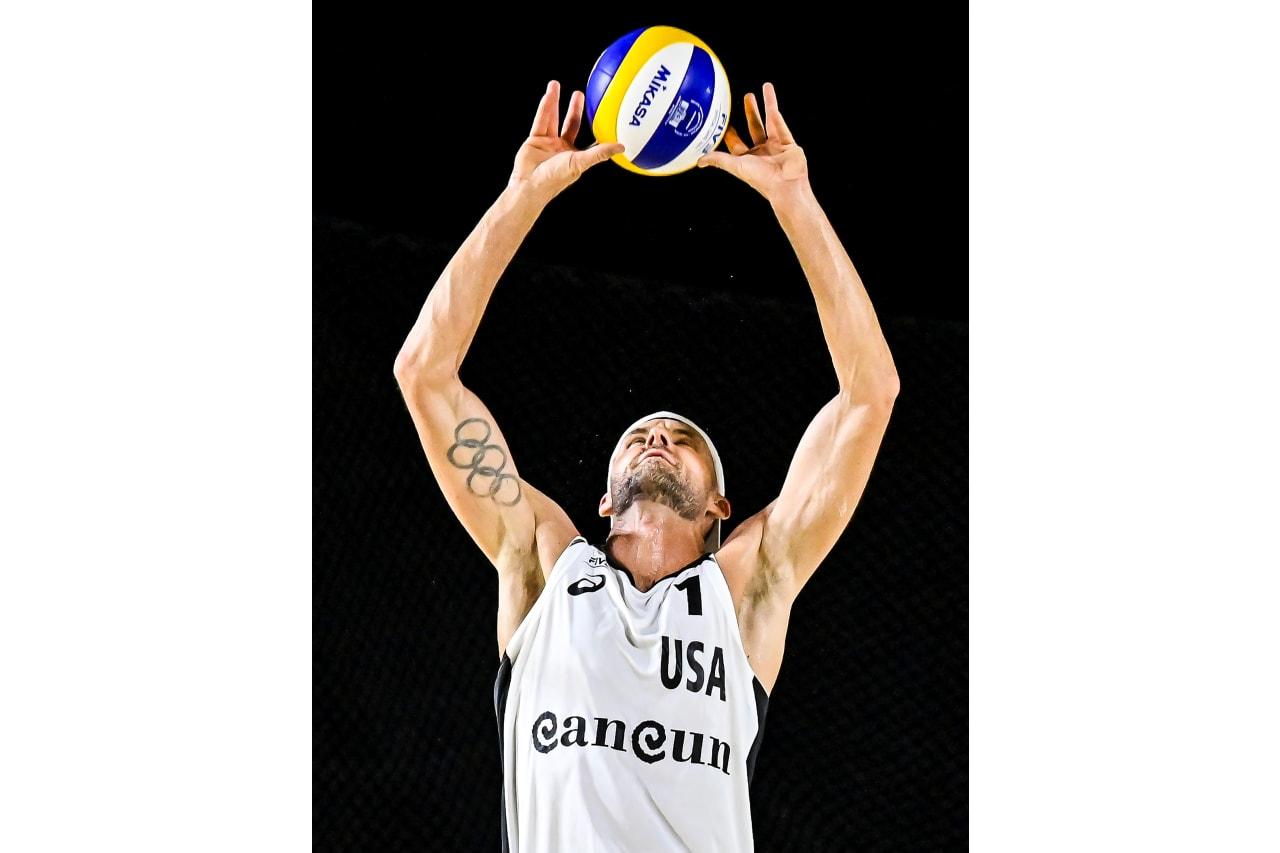 Jacob Gibb (USA) sets the ball