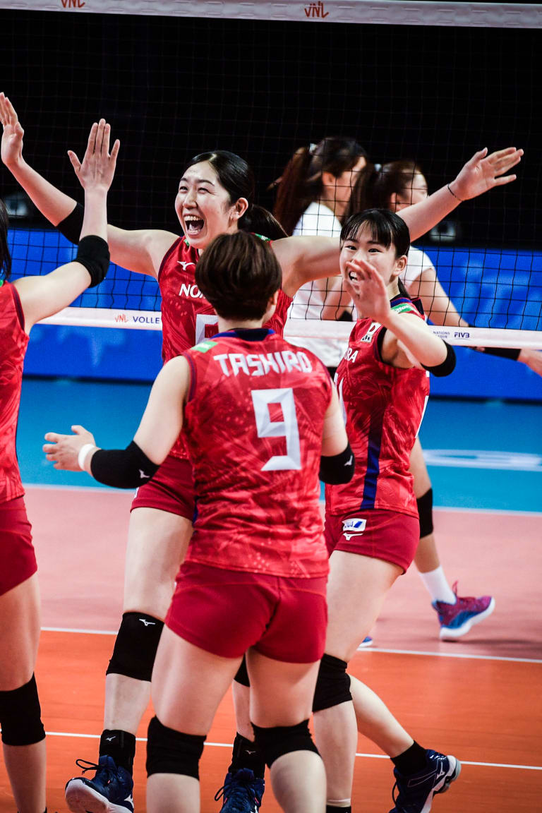 Erika Araki and Japan celebrate a point against Thailand